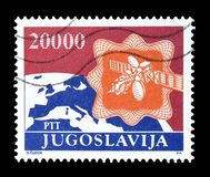 Postage stamp printed by Yugoslavia. Cancelled postage stamp printed by Yugoslavia, that shows Earth and satellite, circa 1989 stock photo