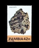 Cancelled postage stamp printed by Zambia. That shows Mineral Vanadinite stock photos