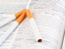 Cancer. Lung cuncer illustrated with cigarettes place on the dictionary Royalty Free Stock Images