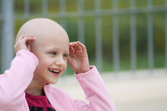 Cancer child. Beautiful caucasian girl undergoing chemotherapy treatmant for cancer in her kidney Stock Photo