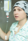 Cancer girl being on a drip stock photography