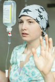 Cancer girl with scarf in hospital Royalty Free Stock Photos