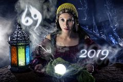 2019 Cancer Predictions. Psychic or fortune teller with crystal ball and horoscope zodiac sign of cancer royalty free stock image