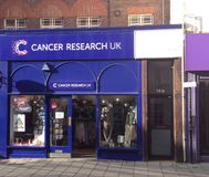 Cancer research charity shop. stock images
