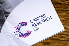 Cancer Research UK. LONDON, UK - DECEMBER 18TH 2017: A close-up of the Cancer Research UK charity logo on an information booklet, on 18th December 2017 Stock Photography