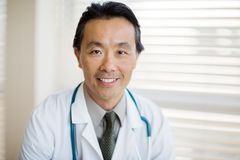 Cancer Specialist With Stethoscope Around Neck In Royalty Free Stock Photography