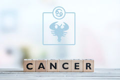 Cancer star sign on a table. Cancer star sign on a wooden table royalty free stock photo