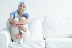 Cancer survivor sitting on sofa Stock Photos