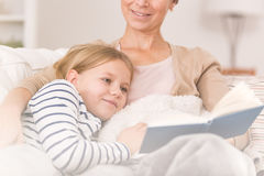 Cancer woman reading to child Stock Images
