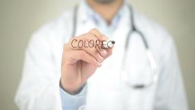 Cancro colorettale, scrittura di medico sullo schermo trasparente video d archivio