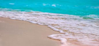 Cancun beach with blue water. Cancun waves hitting the beach Royalty Free Stock Photo