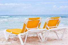 Cancun beach chairs. Beach relaxing chairs in caribbean cancun royalty free stock photography