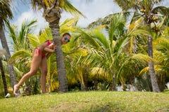 Cancun. Beautiful woman and wild iguana Stock Photography