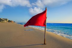 Cancun Delfines Beach red flag Mexico. Cancun Delfines Beach red flag in Mexico Hotel Zone Royalty Free Stock Photos