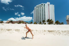 Cancun in Mexico. Beautiful woman on the Cancun beach Stock Photo