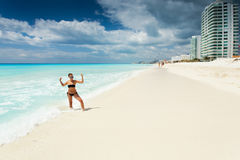 Cancun in Mexico. Beautiful woman on the Cancun beach Royalty Free Stock Images