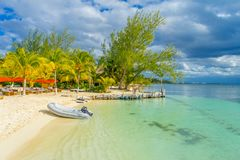 CANCUN, MEXICO - JANUARY 10, 2018: Inflatable boat in the shore of an astonishing beach with transparent water and white stock photography