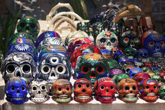 Cancun, Mexico Market: Calavera skulls. Market place in Cancun with vibrant colorful Calavera skulls that are traditional for Day of the Dead festivities Royalty Free Stock Images