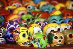 Cancun, Mexico Market: Vibrant Calavera skulls. Vibrant colorful Calavera skulls in an outdoor market place in Cancun, Mexico royalty free stock photos