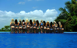 CANCUN, MEXICO - MAY 05: Models Pose By The Edge Of Pool For White T-shirt Project Stock Photos
