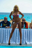 CANCUN, MEXICO - MAY 03: Model walking runway during semi-finals IBMS 2014. At the Mandala Beach Resort on May 03, 2014 in Cancun, Mexico royalty free stock photography