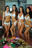 CANCUN, MEXICO - MAY 05: Models getting ready backstage for white t-shirt project. During IBMS - International Bikini Model Search 2014 at the Oasis Sens Resort royalty free stock photos