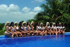 CANCUN, MEXICO - MAY 05: Models pose by the edge of pool for white t-shirt project royalty free stock photos