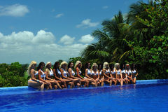 CANCUN, MEXICO - MAY 05: Models pose by the edge of pool for white t-shirt project Stock Photography