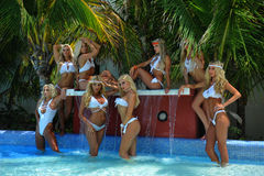 CANCUN, MEXICO - MAY 05: Models pose outside for white t-shirt project. During IBMS - International Bikini Model Search 2014 at the Oasis Sens Resort on May 05 stock photo