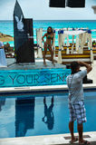 CANCUN, MEXICO - MAY 03: Photographer shoots model on runway during semi-finals IBMS 2014. At the Mandala Beach on May 03, 2014 in Cancun, Mexico stock image