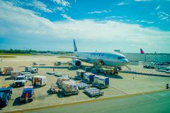 CANCUN, MEXICO - NOVEMBER 12, 2017: Airplanes on the runway of Cancun International Airport in Mexico. Airport is. Located on the Caribbean coast of Yucatan royalty free stock image