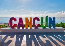 Cancun sign in front of Playa Delfines stock image