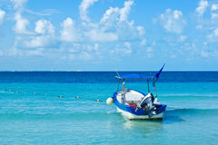 Cancun vacations. Boat in cancun vacations beach Royalty Free Stock Images