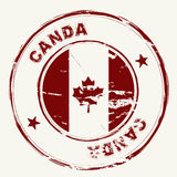 Canda ink stamp. Old fashioned grunge rubber stamp from canada with maple leaf Stock Image
