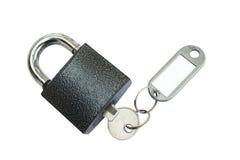 Candado con clave y la etiqueta Imagen de archivo libre de regalías