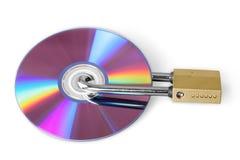 Candado del concepto de la seguridad de datos de Digitaces que cierra el Cd fotografía de archivo