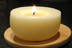 Candel light. Burning white wax candle at night Stock Images
