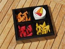 Candela aromatica colorata in casella di legno nera Fotografie Stock