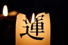 Candela bruciante con un geroglifico Fotografia Stock Libera da Diritti