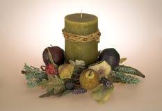 Candela con la base della frutta Fotografie Stock Libere da Diritti