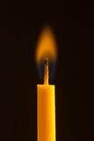 Candela con la fiamma arancio Immagine Stock Libera da Diritti