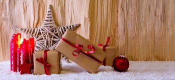 Candela di arrivo e stella di Natale Fotografia Stock Libera da Diritti