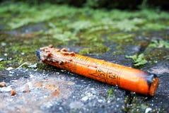 Candela e simboli arancio buddisti Fotografie Stock