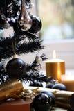 Candela nera dell'oro dell'albero di Natale Immagini Stock Libere da Diritti