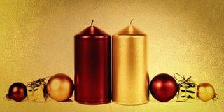 Candela rossa e dorata Fotografie Stock Libere da Diritti