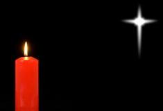 Candela rossa e una stella distante Fotografia Stock Libera da Diritti