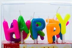 Candela stabilita della scatola per la festa di compleanno, buon compleanno, sulla parte posteriore di bianco Fotografia Stock