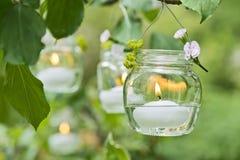 Candela in un vetro Fotografie Stock
