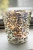 Candela in un vetro del mercurio votivo Fotografia Stock