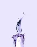 Candela viola dell'acqua Fotografia Stock
